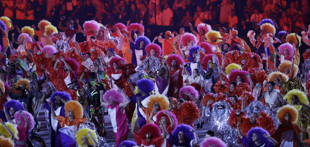 Artists perform during the opening ceremony for the 2016 Summer Olympics in Rio de Janeiro, Brazil, Friday, August 5, 2016. (Photo by Michael Sohn/AP Photo)