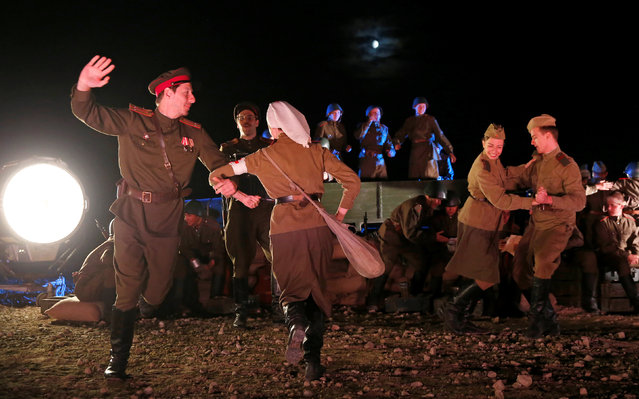 Actors dressed in World War II uniforms perform during the closing ceremony of the International Army Games 2016 at a range in the settlement of Alabino outside Moscow, Russia, August 13, 2016. Picture taken August 13, 2016. (Photo by Maxim Shemetov/Reuters)
