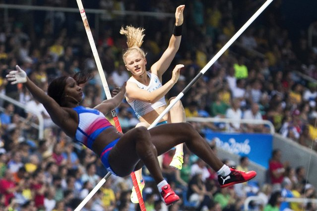 Wilma Murto (back) of Finland and Yarisley Silva (front) of Cuba compete during the women's Pole Vault qualification of the Rio 2016 Olympic Games Athletics, Track and Field events at the Olympic Stadium in Rio de Janeiro, Brazil, 16 August 2016. (Photo by Peter Klaunzer/EPA)