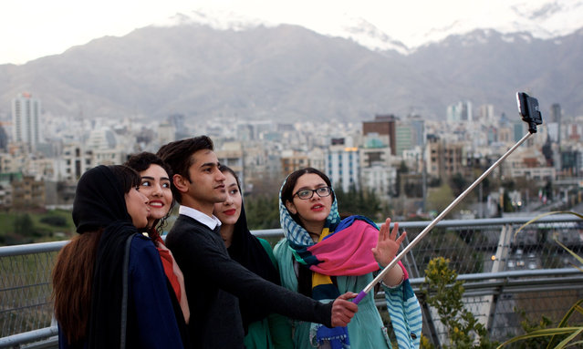 """1: Tehran, Iran. Number one on the """"most improved"""" list is Tehran, after a period of relative political stability. Latest ranking: 126 of 140; Ranking five years ago: 132; Five-year index movement: 5.0%. Here: Iranian youths take a selfie on the Tabi'at (Nature) bridge overlooking Tehran. (Photo by Behrouz Mehri/AFP Photo)"""