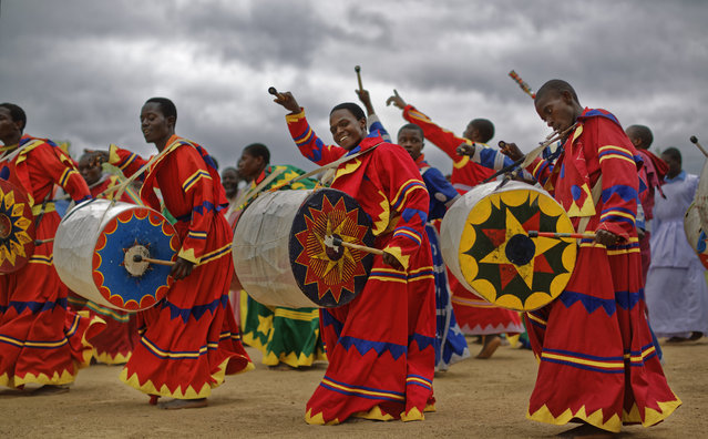 Members of the International Apostolic Ejuwel Jekenisheni Church dance, sing, pray, and play drums during a morning service at the open-air church on the outskirts of Harare, Zimbabwe Sunday, November 19, 2017. A day after huge crowds rallied peacefully in the capital for 93-year-old President Robert Mugabe to step down, Zimbabweans around the country attended Sunday church services praying for peace and the future of their country. (Photo by Ben Curtis/AP Photo)