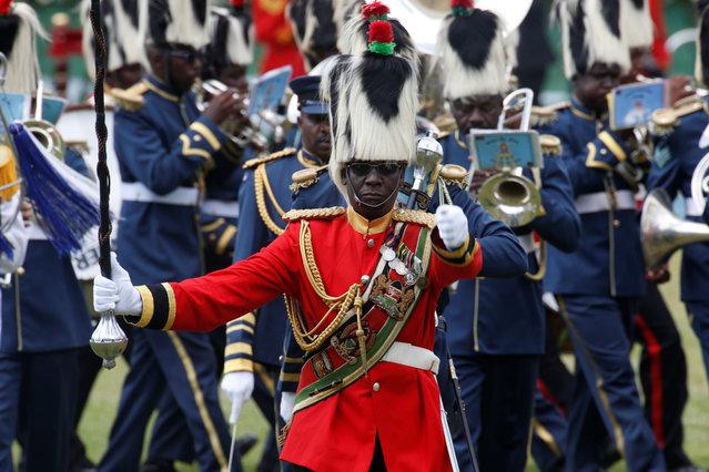 A member of guard of honor is seen ahead of the inauguration ceremony to swear in Kenya's President Uhuru Kenyatta at Kasarani Stadium in Nairobi, Kenya, November 28, 2017. (Photo by Thomas Mukoya/Reuters)