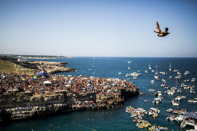 Jonathan Paredes of Mexico dives from the 27 metre platform during the fifth stop of the Red Bull Cliff Diving World Series in Polignano a Mare, Italy on August 28, 2016. (Photo by Dean Treml/ANSA/Red Bull Press Office)
