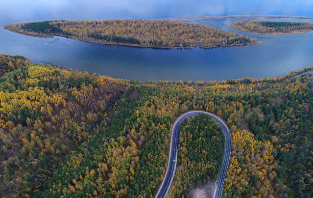 """An aerial view shows the R257 """"Yenisei"""" federal highway in the Siberian Taiga area outside Krasnoyarsk, Russia on September 21, 2017. (Photo by Ilya Naymushin/Reuters)"""