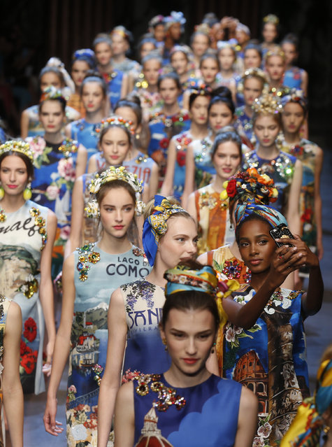 Models take the catwal for Dolce&Gabbana women's Spring-Summer 2016 collection, part of the Milan Fashion Week, unveiled in Milan, Italy, Sunday, September 27, 2015. (Photo by Luca Bruno/AP Photo)