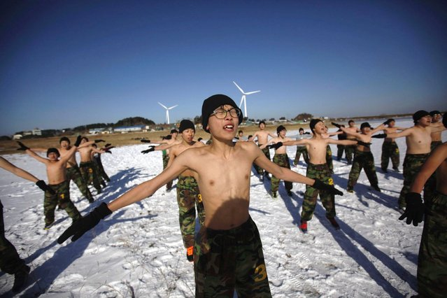 Students exercise during a winter military camp in Ansan, south of Seoul January 3, 2013. Hundreds of students between 11 and 17 years old attend winter boot camp training courses every year. The winter courses range from 4 to 14 days at the Blue Dragon Camp run by retired marines, which also offers summer boot camp for students. REUTERS/Kim Hong-Ji (SOUTH KOREA - Tags: EDUCATION MILITARY SOCIETY)