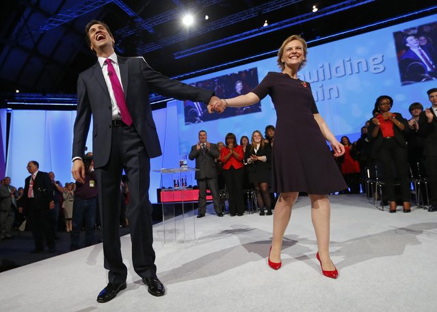 Britain's opposition Labour Party leader Ed Miliband laughs with his wife Justine on stage after delivering his keynote speech at the party's annual conference in Manchester, northern England October 2, 2012. (Photo by Andrew Winning/Reuters)