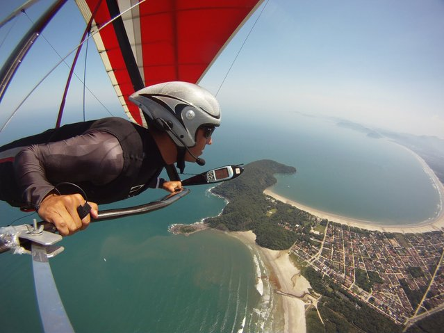 """Bird's eye view! by David Filho. David Filho has the best seat in the house hanggliding over Rio"". (Photo by David Filho)"