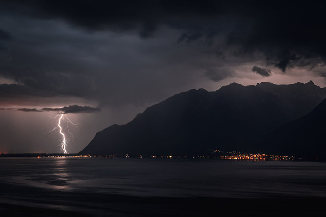 Lightning illuminates the region of Chablais during a storm seen from Chexbres, above Lake Geneva, western Switzerland, on August 16, 2020. (Photo by Fabrice Coffrini/AFP Photo)