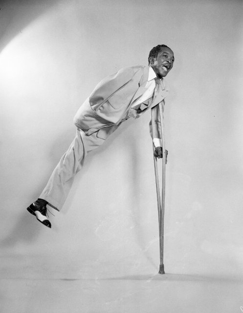 Crip Heard, one-armed and one-legged artist of the dance, takes off with the aid of his crutch, Los Angeles, October 16, 1952. (Photo by Don Brinn/AP Photo)