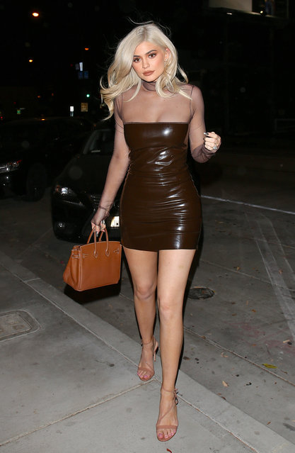 Kylie Jenner is struck by a breeze as she arrives for dinner at Catch LA in West Hollywood on September 22, 2016, in a sheer top patten leather dress and heels. (Photo by AKM/XposurePhotos.com)