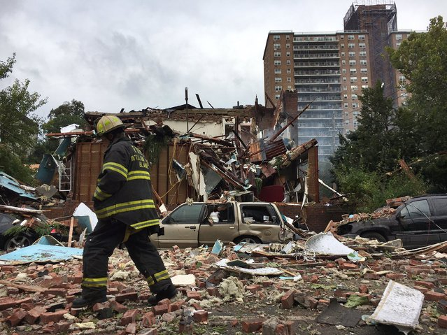 A New York City firefighter walks through debris after an explosion ripped through a home in the New York City borough of the Bronx, New York September 27, 2016. (Photo by Reuters/New York City Mayor's Office)