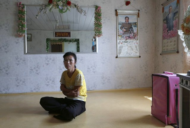 North Korean farmer O Yong Ae sits at her home during an interview at the Migok Cooperative farm in Sariwon, North Hwanghae Province, North Korea, on September 23, 2012. Farmers would be able to keep a bigger share of their crops under proposed changes aiming to boost production by North Korea's collective farms, which have chronically struggled to provide enough food for the country's 24 million people. Current rules require them to turn everything over to the state beyond what farmers can keep to feed their families. (Photo by Vincent Yu/AP Photo)