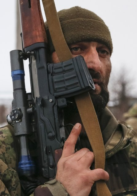 """A Pro-Russian separatist from the Chechen """"Death"""" battalion takes part in a training exercise in the territory controlled by the self-proclaimed Donetsk People's Republic, eastern Ukraine, December 8, 2014. (Photo by Maxim Shemetov/Reuters)"""
