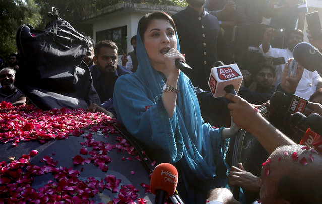 Maryam Nawaz, daughter of former Pakistani Prime Minister Nawaz Sharif and leader of an opposition party, addresses supporters while leaving her home to attend a rally in Lahore, Pakistan, Friday, October 16, 2020. Pakistani opposition parties are staging a rally in the eastern city of Gujranwala to kick off their campaign against Prime Minister Imran Khan to force him step down over what they say is his failure in handling the nation's ailing economy. (Photo by K.M. Chaudary/AP Photo)
