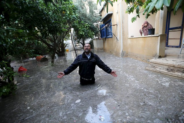 A Palestinian man reacts after his house was flooded by rain water in Khan Younis in the southern Gaza Strip, November 9, 2015. (Photo by Ibraheem Abu Mustafa/Reuters)