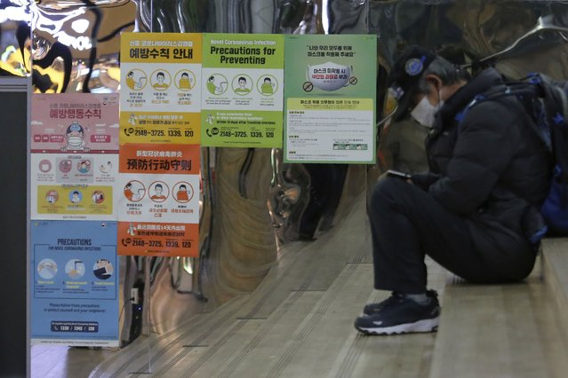 """Posters on precautions against the coronavirus are displayed at a subway station in Seoul, South Korea, Tuesday, November 24, 2020. The signs on posters read """"Precautions against the coronavirus and please wear a mask"""". (Photo by Ahn Young-joon/AP Photo)"""