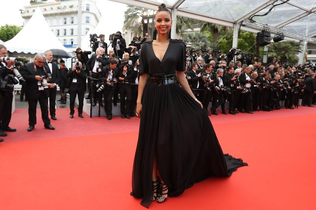 """Former Miss France 2014 Flora Coquerel poses as she arrives on May 14, 2018 for the screening of the film """"BlacKkKlansman"""" at the 71 st edition of the Cannes Film Festival in Cannes, southern France. (Photo by Valery Hache/AFP Photo)"""