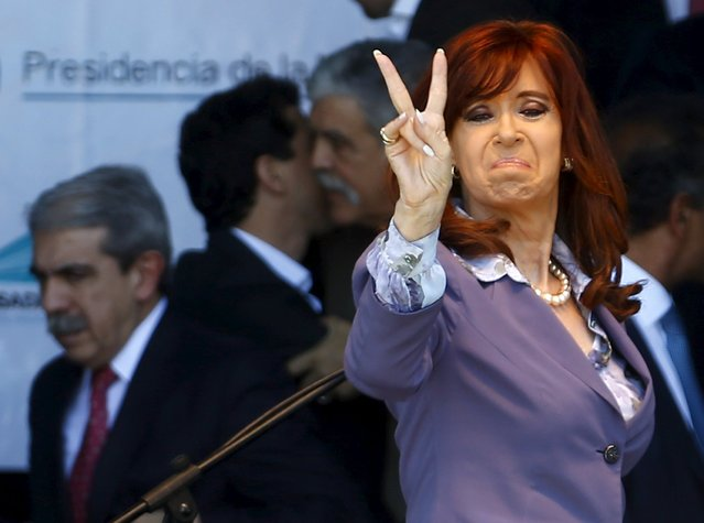 Outgoing Argentine President Cristina Fernandez de Kirchner gestures at supporters after attending a ceremony in the Posadas Hospital in the province of Buenos Aires, November 25, 2015. (Photo by Enrique Marcarian/Reuters)