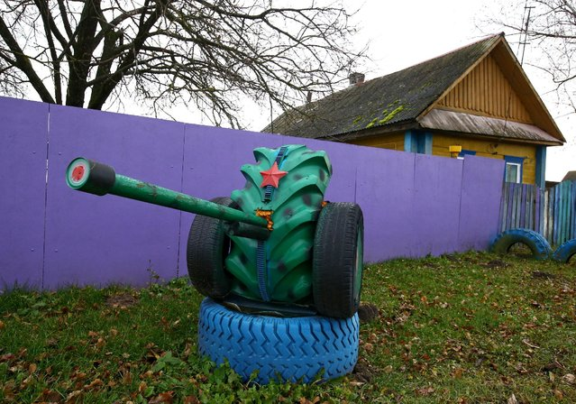 An installation with a copy of a cannon is seen at a villager's house in the village of Vits, Belarus November 8, 2016. (Photo by Vasily Fedosenko/Reuters)
