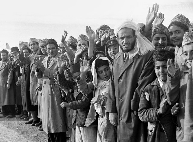 Residents of Afghanistan line the route of U.S. President Dwight Eisenhower's tour in Kabul, Afghanistan, on December 9, 1959. (Photo by AP Photo via The Atlantic)
