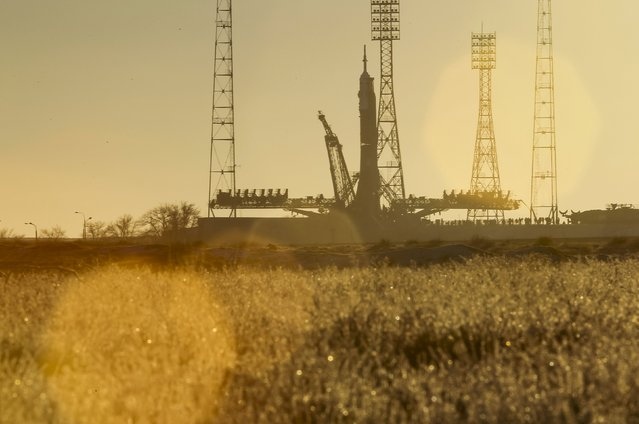 The Soyuz TMA-19M is silhouetted against the sunrise after being lifted on its launchpad at the Baikonur cosmodrome, Kazakhstan, December 13, 2015. (Photo by Shamil Zhumatov/Reuters)