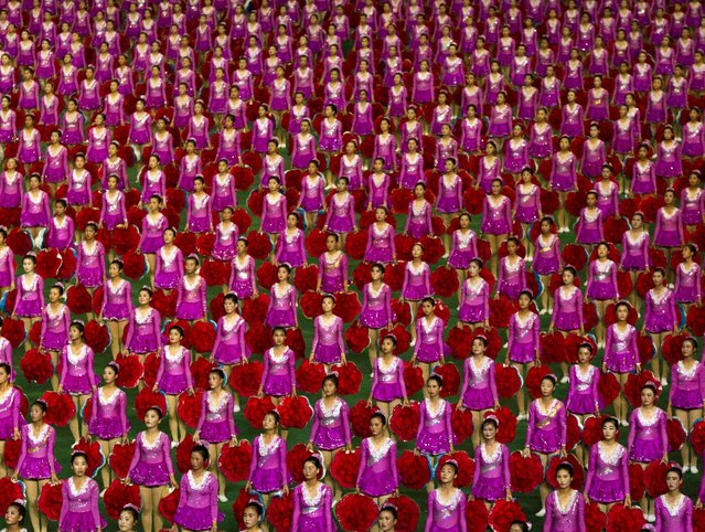"North Korean girls stand at attention at the end of a performance of the ""Arirang"" mass games at May Day Stadium in Pyongyang Friday, July 26, 2013 on the eve of the 60th anniversary of the Korean War armistice. (Photo by David Guttenfelder/AP Photo)"