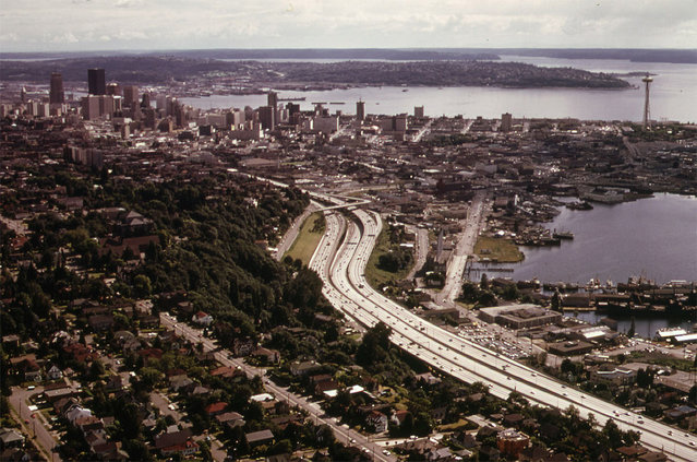 The City of Seattle and Interstate Highway 5, with Elliott Bay at right, seen in June of 1973. (Photo by Doug Wilson/NARA via The Atlantic)