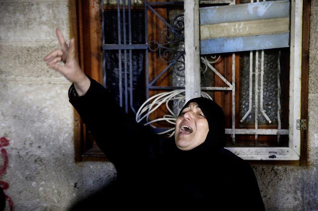 A Palestinian woman chants Islamic slogans during the funeral of Hani Wahdan, 22, at his family house in Gaza City, Saturday, December 26, 2015. (Photo by Adel Hana/AP Photo)