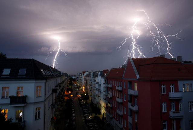 Lightnings strike over buildings during a thunderstorm in Berlin, June 2012. (Photo by Pawel Kopczynski/Reuters)