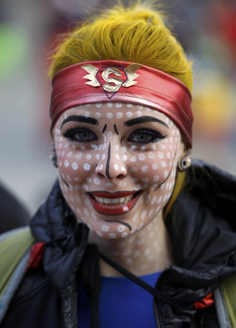 "A woman dressed in a costume of Superwoman poses at ""Weiberfastnacht"" (Women's Carnival) in Cologne February 12, 2015. (Photo by Ina Fassbender/Reuters)"