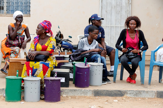 Polling officials wait at the local IEC (Independent Electoral Commission) headquarters to distribute the ballot boxes to the polling stations, in Serekunda, Gambia, November 29, 2016. (Photo by Thierry Gouegnon/Reuters)