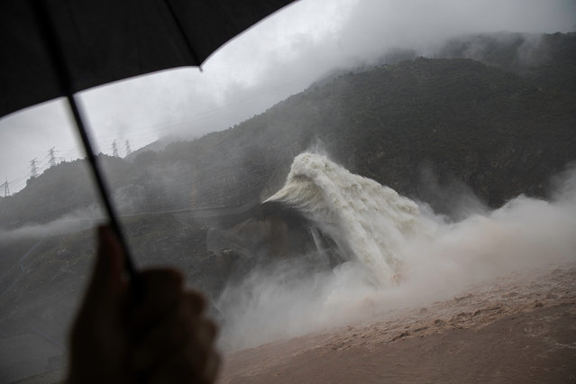 Water is released as heavy rain falls at a massive Pubugou Dam on the Dadu river, a tributary of the Yangtze River in Hanyuan County of Sichuan province, China on August 30, 2018. (Photo by Damir Sagolj/Reuters)