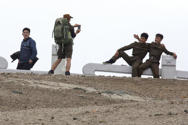 In this Saturday, August 18, 2018, photo, Paula of Australia takes a photo for North Koreans during a hike arranged by Roger Shepherd of Hike Korea on Mount Paektu in North Korea. Hoping to open up a side of North Korea rarely seen by outsiders, Shepherd, a New Zealander who has extensive experience climbing the mountains of North and South Korea is leading the first group of foreign tourists allowed to trek off road and camp out under the stars on Mount Paektu, a huge volcano that straddles the border that separates China and North Korea. (Photo by Ng Han Guan/AP Photo)