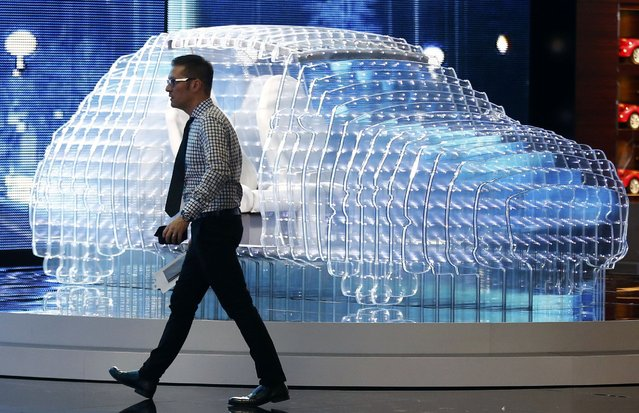 A man walks past a so-called Lightmobile based on a Karl model by Opel ahead of the 85th International Motor Show in Geneva, March 2, 2015.        REUTERS/Arnd Wiegmann (SWITZERLAND  - Tags: TRANSPORT BUSINESS)