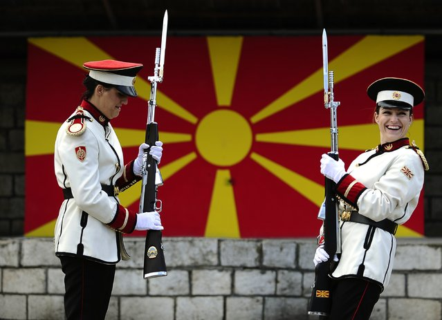 Corporals Verica Zlatevska (L) and Dragana Kitanovska attend an honour guard training session at an army barracks in Skopje March 4, 2015. Macedonia's honour army battalion, the ceremonial uniformed guard that receives every foreign president, dignitaries and delegations, but also sees off and welcomes the head of state every time he leaves the country, has a different glow. For the first time in the history of Macedonia's army, the honour guard has two women in its ranks. There has not been an event in which one of them is not in the first row. Zlatevska joined the army in 2003, Kitanovska in 2006. Picture taken March 4, 2015.   REUTERS/Ognen Teofilovski (MACEDONIA - Tags: MILITARY SOCIETY TPX IMAGES OF THE DAY)