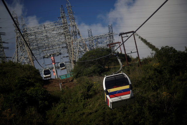 A cable car travels over to the top of El Avila National Park in Caracas, Venezuela, December 6, 2016. (Photo by Ueslei Marcelino/Reuters)