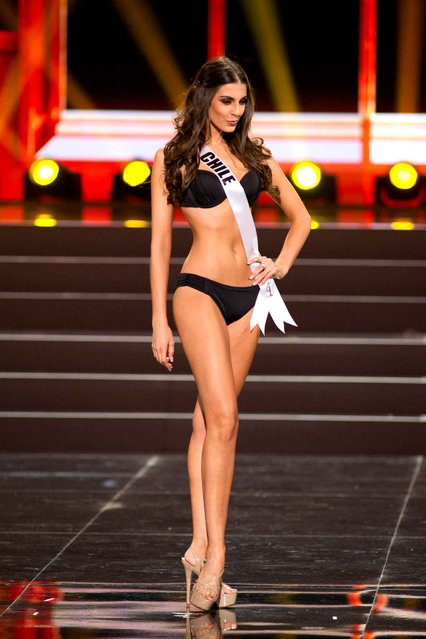 This photo provided by the Miss Universe Organization shows Maria-Jesus Matthei, Miss Chile 2013, competes in the swimsuit competition during the Preliminary Competition at Crocus City Hall, Moscow, on November 5, 2013. (Photo by Darren Decker/AFP Photo)