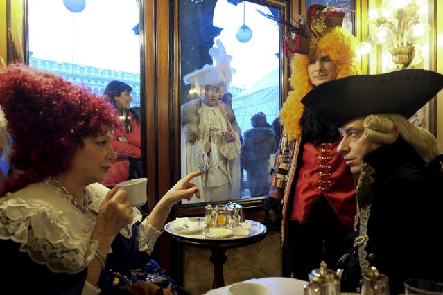 Revellers sit at the Caffe Florian coffee shop in Saint Mark's Square during the Venice Carnival, Italy January 31, 2016. (Photo by Manuel Silvestri/Reuters)