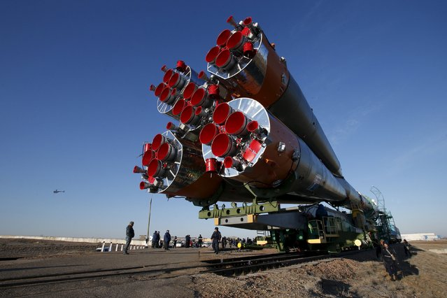 The Soyuz TMA-16M spacecraft is transported to its launch pad at the Baikonur cosmodrome March 25, 2015. The Soyuz is scheduled to blast off from Kazakhstan on March 28, with Russian cosmonauts Mikhail Kornienko, Gennady Padalka and NASA astronaut Scott Kelly to the International Space Station. (Photo by Maxim Zmeyev/Reuters)