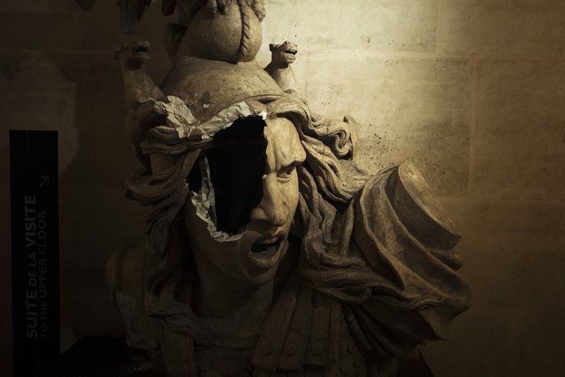 A broken sculpture of Marianne, symbol of the French Repupblic, appears damaged in the gallery inside the Arc de Triomphe during a demonstration Saturday, December 1, 2018 in Paris. A French protest against rising taxes and the high cost of living turned into a riot Saturday in Paris as police fired tear gas and water cannon in street battles with activists wearing the fluorescent yellow vests of a new movement. (Photo by Kamil Zihnioglu/AP Photo)