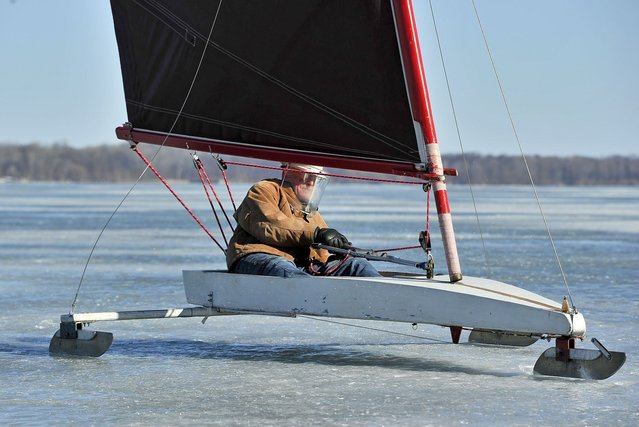 "Mike Smith, 65, of Erie, Pa., ice sails, Tuesday, March 24 on Presque Isle Bay, near Ferncliff Beach, at the Erie Yacht Club in Erie. Pa. ""Ice boats were the rocket ships of their time"", said Smith. ""They were the fastest things on earth"". (Photo by Sarah Crosby/AP Photo/Erie Times-News)"