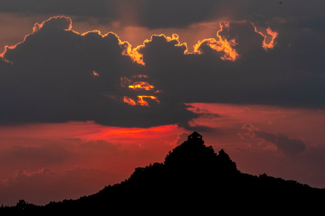 Fort Salgo is silhouetted by the setting sun near Salgotarjan, Hungary, 28 June 2021. (Photo by Peter Komka/EPA/EFE)