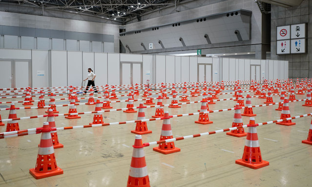 Lines for Covid test sample collections inside the main press and international broadcast centre building for the Tokyo 2020 Olympics in Tokyo, Japan on July 5, 2021. The Games are due to start on 23 July. (Photo by AFLO/Rex Features/Shutterstock)
