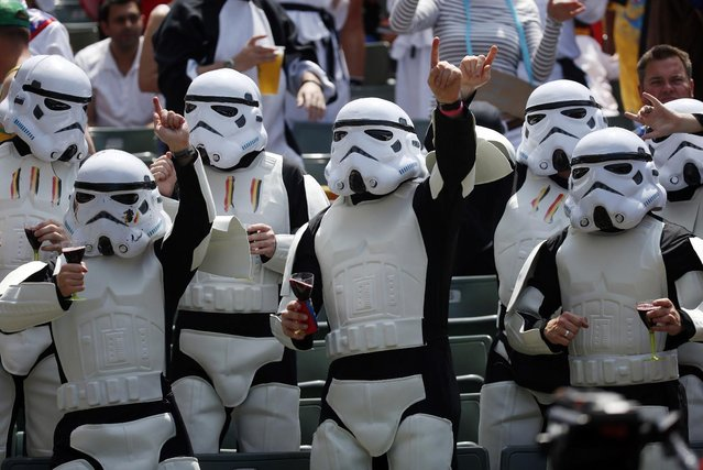 """Rugby fans dress as Stormtroopers, the character from movie """"Star Wars"""" during a second day match of the Hong Kong Sevens rugby tournament in Hong Kong, Saturday, March 28, 2015. (Photo by Kin Cheung/AP Photo)"""