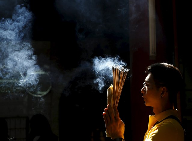 A man prays at the temple during Chinese New Year celebrations in Kuala Lumpur, Malaysia, February 9, 2016. (Photo by Olivia Harris/Reuters)