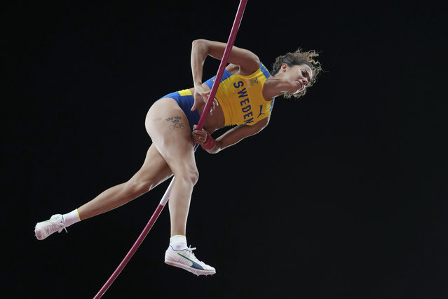 Angelica Bengtsson, of Sweden, competes in the final of the women's pole vault at the 2020 Summer Olympics, Thursday, August 5, 2021, in Tokyo. (Photo by Matthias Schrader/AP Photo)