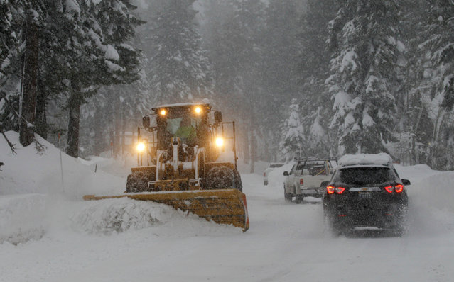 Snow is cleared from a residential road during a winter storm in Incline Village, Nevada, U.S. January 7, 2017. (Photo by Bob Strong/Reuters)