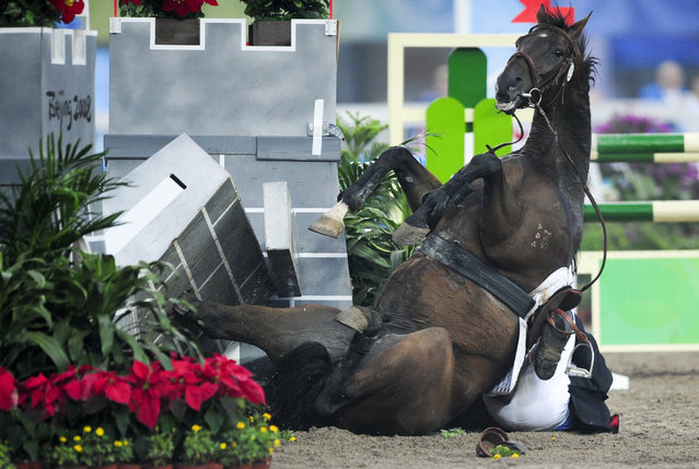 Michal Michalik of Czech Republic during the men's riding show jumping event of the modern pentathlon competition at the Beijing 2008 Olympic Games, August  2008. (Photo by Desmond Boylan/Reuters)
