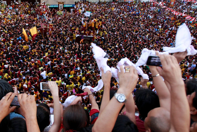 Devotees wave towels while taking part in the annual procession of the Black Nazarene in Manila, Philippines January 9, 2017. (Photo by Czar Dancel/Reuters)